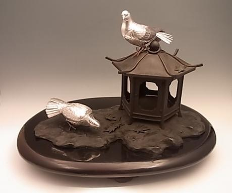 JAPANESE EARLY 20TH C. SILVER AND BRONZE PIDGEON AND LANTERN OKIMONO BY KANO SEIUN <br><font color=red><b>SOLD</b></font>