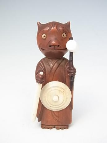 JAPANESE EARLY 20TH CENTURY KOBE TOY IN THE SHAPE OF AN ONI DRESSED AS A MONK<br><font color=red><b>SOLD</b></font>
