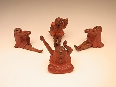 JAPANESE EARLY 20TH CENTURY SET OF CARVED DARUMA (4)<br><font color=red><b>SOLD</b></font>