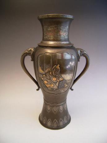 Pair of Large Japanese Bronze Vases with Dragons.