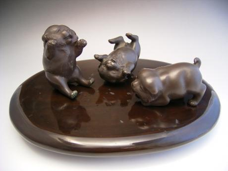 JAPANESE EARLY 20TH CENTURY TRIO OF BRONZE PUPPIES BY KOZAN<br><font color=red><b>SOLD</b></font>