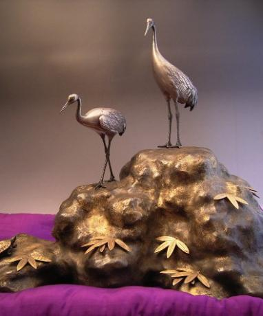 JAPANESE MID 20TH CENTURY PURE SILVER CRANES AND BRONZE TORTOISE ON BRONZE BASE
