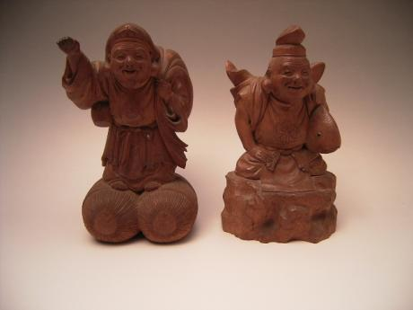 JAPANESE LATE MEIJI PERIOD CHERRYWOOD CARVINGS OF DAIKOKU AND EBISU, SIGNED<br><font color=red><b>SOLD</b></font>