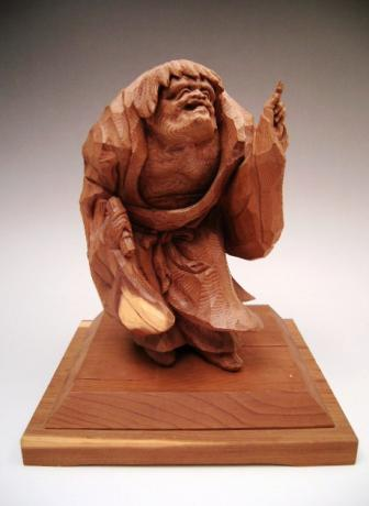 JAPANESE 20TH CENTURY WOODEN CARVING OF IMMORTAL NAMED KANZAN