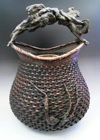 JAPANESE EARLY 20TH CENTURY LARGE BAMBOO FLOWER BASKET WITH ROOT HANDLE<br><font color=red><b>SOLD</b></font>