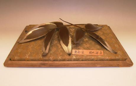 JAPANESE EARLY 20TH CENTURY OKIMONO OF BAMBOO LEAVES AND FIREFLY<br><font color=red><b>SOLD</b></font>