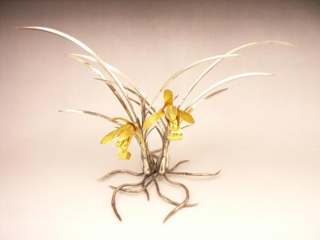 JAPANESE EARLY 20TH CENTURY PURE SILVER CYMBIDIUM ORCHID OKIMONO<br><font color=red><b>SOLD</b></font>