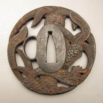 JAPANESE MID EDO PERIOD AKAO TSUBA WITH EXOTIC PALM DESIGN